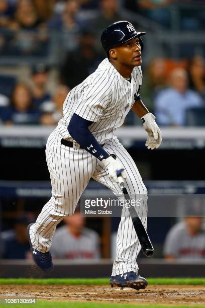 Miguel Andujar of the New York Yankees hits a solo home run in the second inning against the Boston Red Sox at Yankee Stadium on September 19 2018 in...