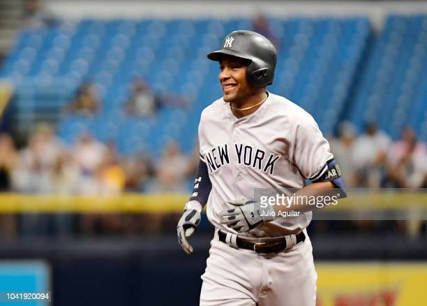 Miguel Andujar of the New York Yankees hits a three-run homer in the first inning against the Tampa Bay Rays on September 27, 2018 at Tropicana Field...