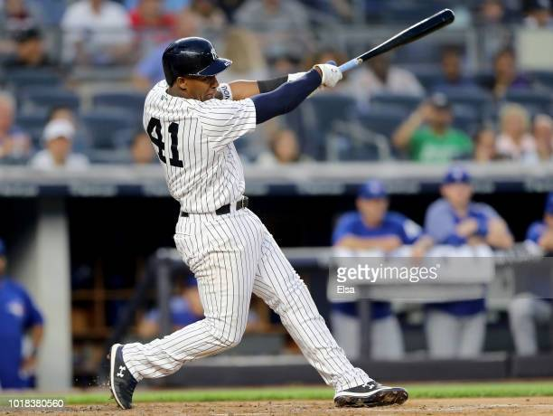 Miguel Andujar of the New York Yankees hits an RBI double in the first inning against the Toronto Blue Jays at Yankee Stadium on August 17 2018 in...