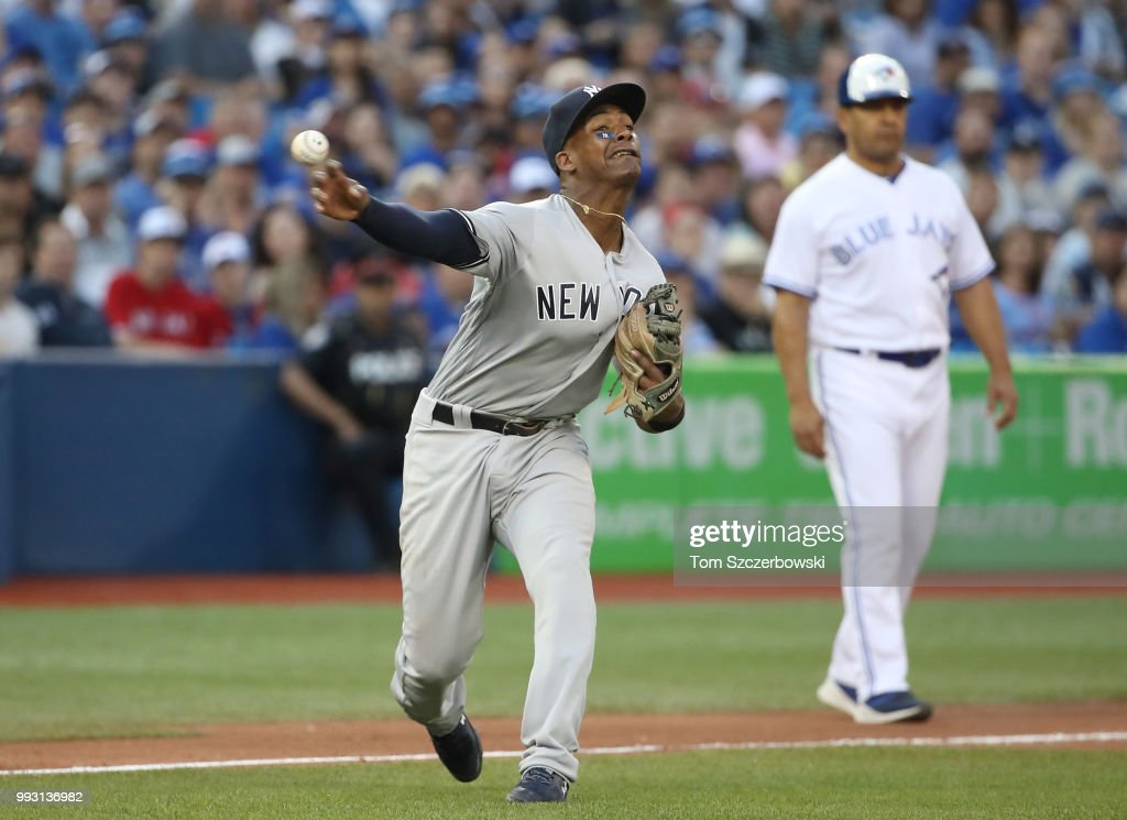 Miguel Andujar #41 of the New York Yankees makes a throwing error in the fourth inning during MLB game action against the Toronto Blue Jays at Rogers Centre on July 6, 2018 in Toronto, Canada.