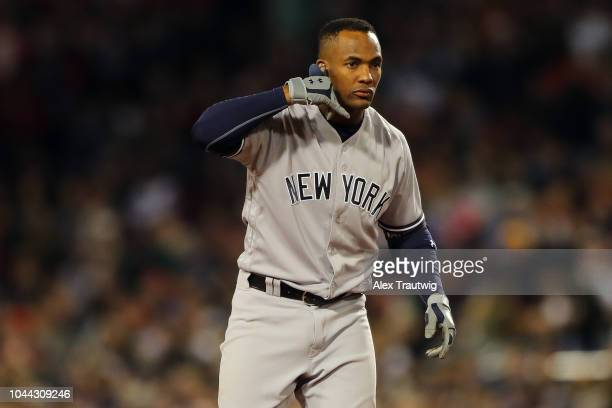 Miguel Andujar of the New York Yankees reacts after hitting a double during the game against the Boston Red Sox at Fenway Park on Friday September 28...