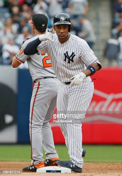 Miguel Andujar of the New York Yankees reacts towards his dugout as if he is holding a phone after hitting a double in the third inning in an MLB...