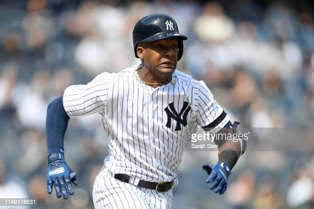 Miguel Andujar of the New York Yankees runs to first base during the first inning of the game against the Baltimore Orioles at Yankee Stadium on...