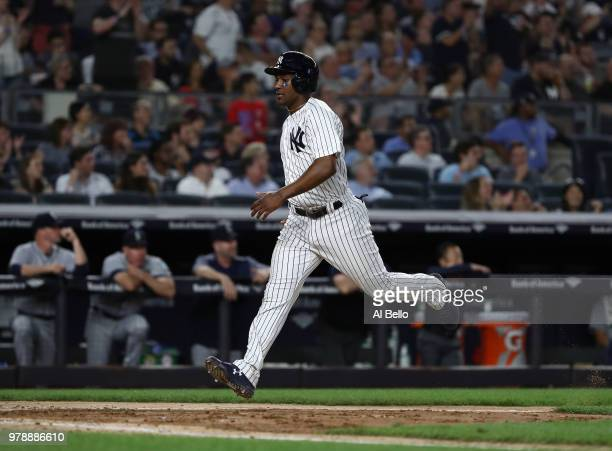 Miguel Andujar of the New York Yankees scores off of a hit by Aaron Judge against the Seattle Mariners in the seventh inning during their game at...