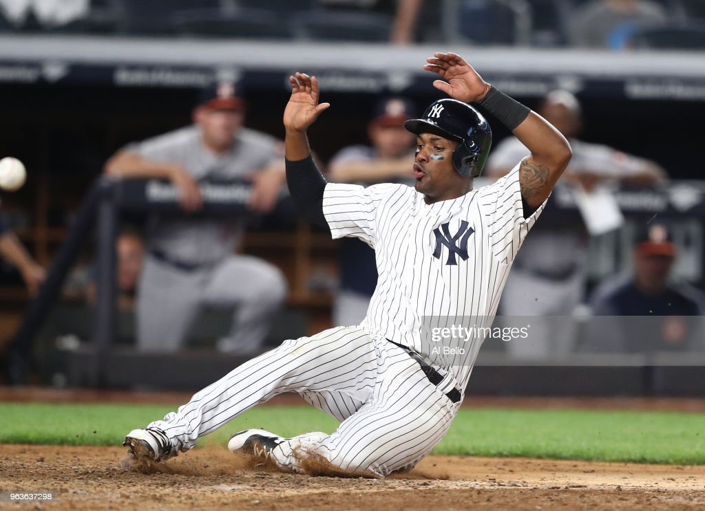 Miguel Andujar #41 of the New York Yankees scores the winning run in the tenth inning against the Houston Astros during their game at Yankee Stadium on May 29, 2018 in New York City.