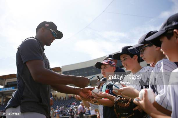 Miguel Andujar of the New York Yankees signs autographs for fans prior to a Grapefruit League spring training game against the Washington Nationals...