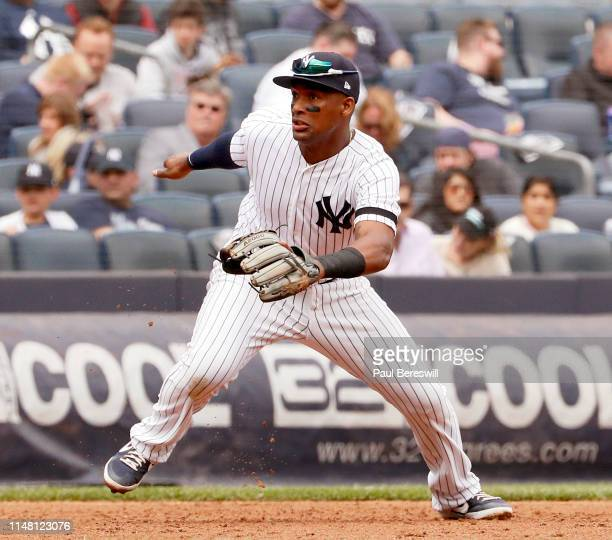 Miguel Andujar of the New York Yankees starts to charge a ground ball at third base in an MLB baseball game against the Minnesota Twins on May 4,...