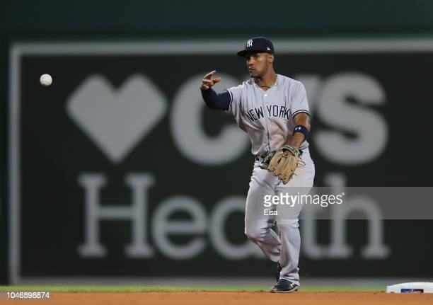 Miguel Andujar of the New York Yankees throws to first base for the out in the fifth inning during Game Two of the American League Division Series...