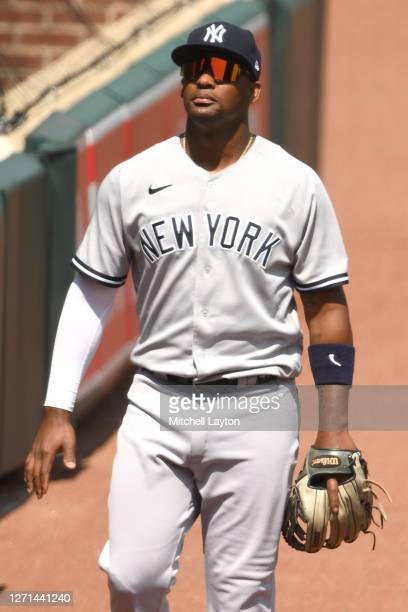 Miguel Andujar of the New York Yankees walks to the dug out before a baseball game against the Baltimore Orioles at Oriole Park at Camden Yards on...