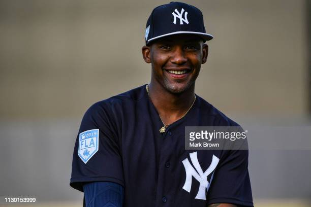Miguel Andujar of the New York Yankees warms up before the spring training game against the Baltimore Orioles at Steinbrenner Field on March 12, 2019...