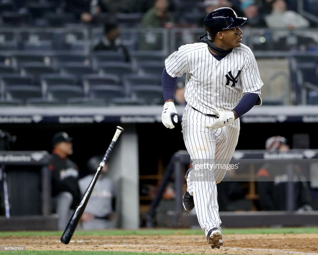 Miguel Andujar #41 of the New York Yankees watches his solo home run in the ninth inning against the Miami Marlins at Yankee Stadium on April 17, 2018 in the Bronx borough of New York City.