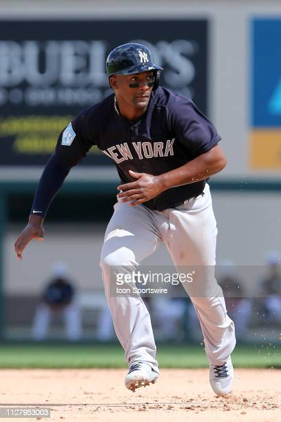 Miguel Andujar of the Yankees hustles over to third base during the spring training game between the New York Yankees and the Detroit Tigers on...