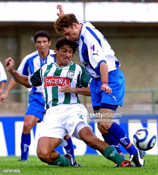 Miguel Angel Abrigo of the Oriente Petrolero of Bolivia fights Mauricio Dinamarca of Paraguay for the ball during the Copa Libertadores 20 February...