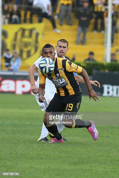 Miguel Angel Borja of Olimpo vies for the ball during a match between Olimpo and Estudiantes as part of 10th round of Torneo de Transicion 2014 at...