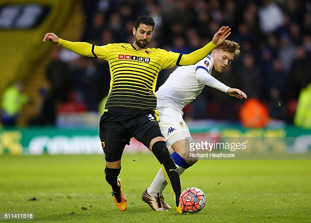 Miguel Angel Britos of Watford and Lee Erwin of Leeds United compete for the ball during the Emirates FA Cup fifth round match between Watford and...