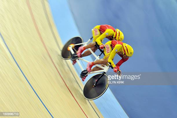 Miguel Angel Clemente Solano and Diego Javier Munoz of Spain compete in the men's individual B pursuit qualifying cycling event during the London...