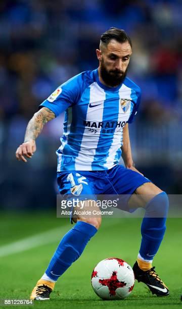 Miguel Angel Garrido Cifuentes of Malaga CF controls the ball during the Copa del Rey match between Malaga CF and Numancia at La Rosaleda Stadium on...