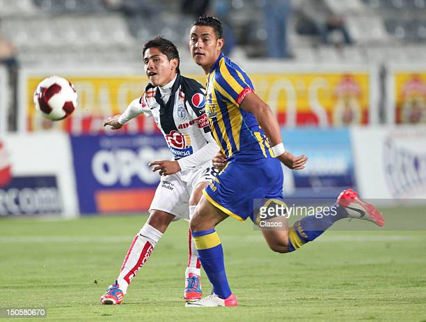 Miguel Angel Herrera of Pachuca and Jose Pina of La Piedad in action during a match between Pachuca and La Piedad as part of the Copa MX 2012 on...