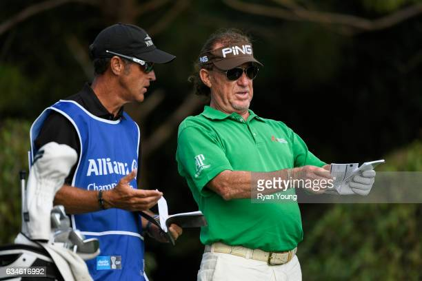 Miguel Angel Jimenez and his caddy discuss their tee shot on the 16th hole during the first round of the PGA TOUR Champions Allianz Championship at...