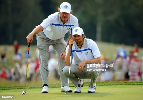 Miguel Angel Jimenez and Sergio Garcia of the European team line up a putt during the afternoon fourball matches on day one of the 2008 Ryder Cup at...