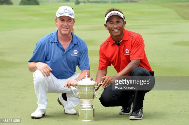 Miguel Angel Jimenez, Captain of Team Europe and Thongchai Jaidee, Captain of Team Asia are pictured together with the trophy after the first EurAsia...
