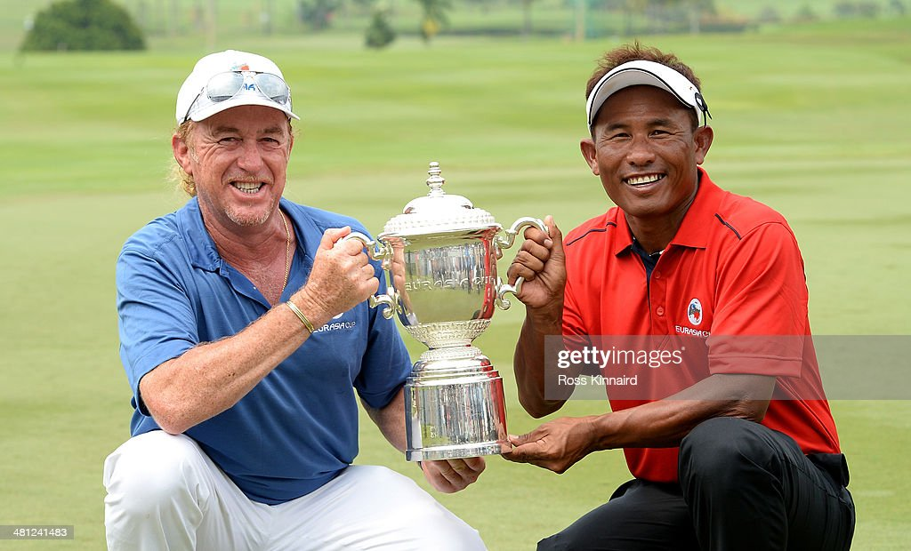 Miguel Angel Jimenez, Captain of Team Europe and Thongchai Jaidee, Captain of Team Asia are pictured together with the trophy after the first EurAsia Cup finished in a tie. They are pictured after the single matches on day three of the EurAsia Cup at Glenmarie G&CC on March 29, 2014 in Kuala Lumpur, Malaysia.