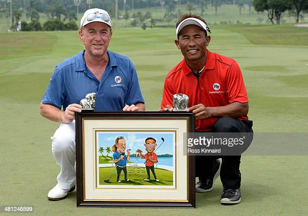 Miguel Angel Jimenez Captain of Team Europe and Thongchai Jaidee Captain of Team Asia present each other with gifts after the singles matches on day...