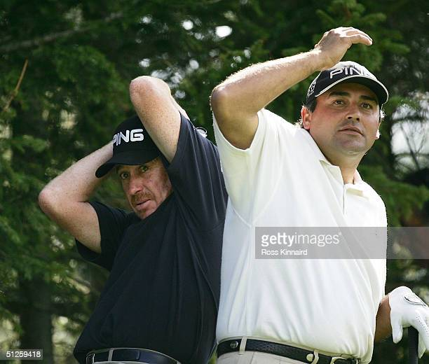 Miguel Angel Jimenez of Spain and Angel Cabrera of Argentina take cover from a wayward golf ball during the second round of The Omega European...