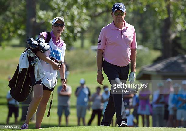 Miguel Angel Jimenez of Spain and his wife Susanne walk up to the 16th hole during the second round of the Shaw Charity Classic at the Canyon Meadows...