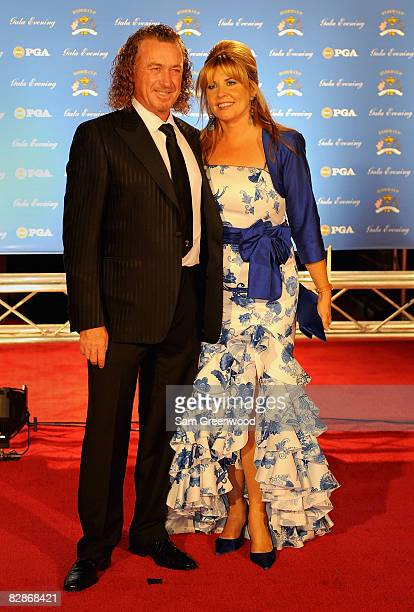 Miguel Angel Jimenez of Spain and the European Ryder Cup team poses with his wife Montserrat Bravo Ramirez on the red carpet before the Ryder Cup...