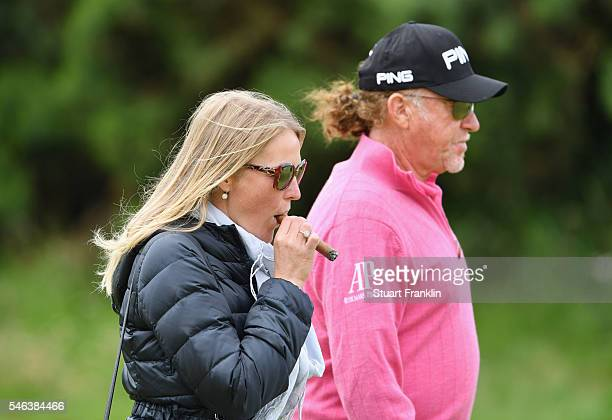 Miguel Angel Jimenez of Spain and wife Susanna Styblo looks on during a practice round ahead of the 145th Open Championship at Royal Troon on July 12...