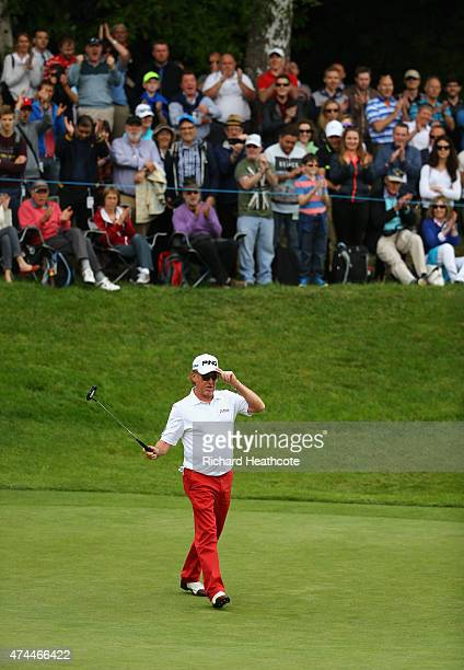 Miguel Angel Jimenez of Spain celebrates a birdie on the 3rd hole during day 3 of the BMW PGA Championship at Wentworth on May 23 2015 in Virginia...