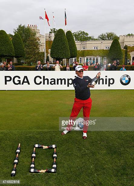 Miguel Angel Jimenez of Spain celebrates after his record tenth hole-in-one on the European Tour during day 3 of the BMW PGA Championship at...