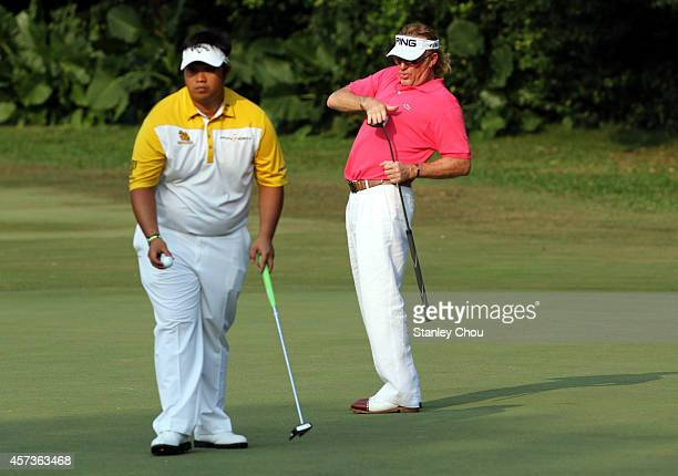 Miguel Angel Jimenez of Spain celebrates by pretending to put a sword away on the 16th hole during the 2nd round of the 2014 Hong Kong open at The...
