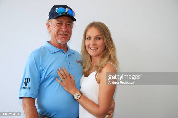 Miguel Angel Jimenez of Spain celebrates his 700th European Tour event with his wife Susanna Styblo prior to the 148th Open Championship held on the...