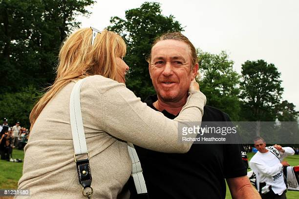 Miguel Angel Jimenez of Spain celebrates winning the BMW PGA Championship with his wife Monserrat after the 2nd playoff hole on the 18th green during...