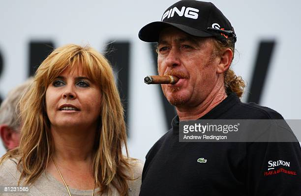 Miguel Angel Jimenez of Spain celebrates winning the BMW PGA Championship with his wife Monserrat and a cigar after the 2nd playoff hole on the 18th...