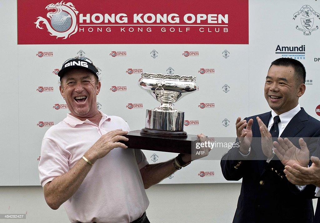 Miguel Angel Jimenez (L) of Spain celebrates winning the Hong Kong Open at the Hong Kong Golf Club in Hong Kong on December 8, 2013.
