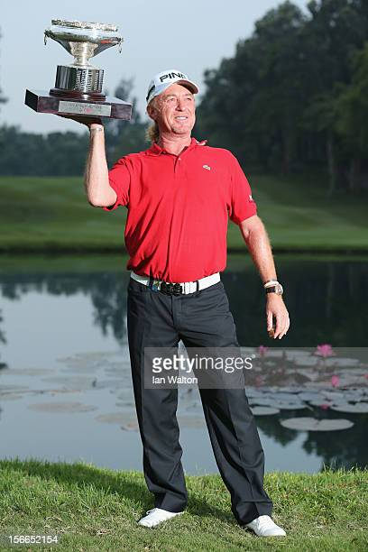 Miguel Angel Jimenez of Spain celebrates with the trophy after winning the UBS Hong Kong Open at The Hong Kong Golf Club on November 18 2012 in Hong...