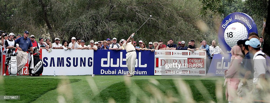 Miguel Angel Jimenez of Spain drives at the 18th hole during the third round of the 2005 Dubai Desert Classic on the Majilis Course at the Emirates Golf Club, on March 05, 2005, in Dubai, United Arab Emirates.