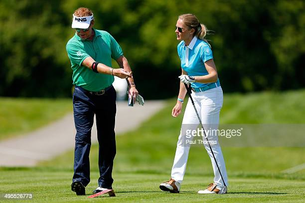 Miguel Angel Jimenez of Spain gestures as he speaks with his wife Susanne Jimenez during the Lyoness Open preview day at the Diamond Country Club on...