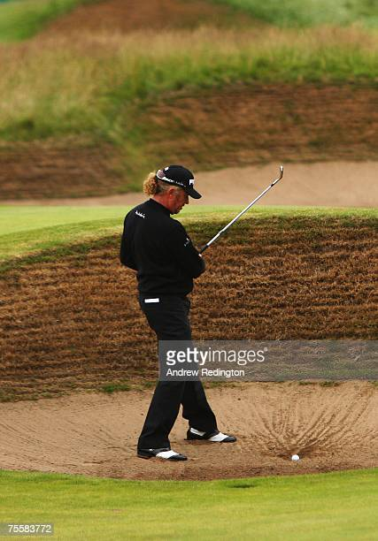 Miguel Angel Jimenez of Spain hits a bunker shot on the 14th hole during the third round of The 136th Open Championship at the Carnoustie Golf Club...