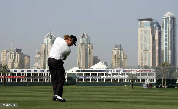 Miguel Angel Jimenez of Spain hits a shot on the 17th hole during the first round at the Dubai Desert Classic at the Emirates Golf Club in Dubai 31...