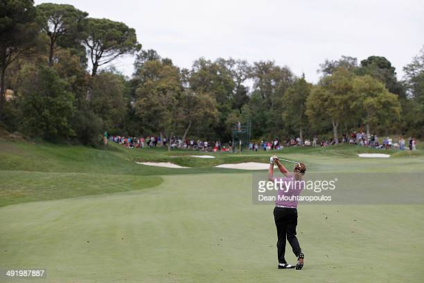 Miguel Angel Jimenez of Spain hits his second shot on the 14th hole during the final round of the Open de Espana held at PGA Catalunya Resort on May...