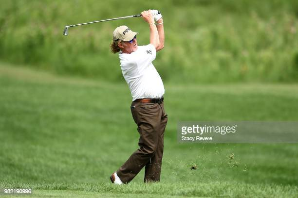 Miguel Angel Jimenez of Spain hits his second shot on the 18th hole during the second round of the American Family Insurance Championship at...