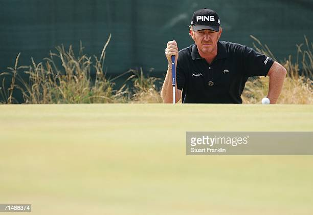 Miguel Angel Jimenez of Spain lines up a putt on the 5th green during the first round of The Open Championship at Royal Liverpool Golf Club on July...