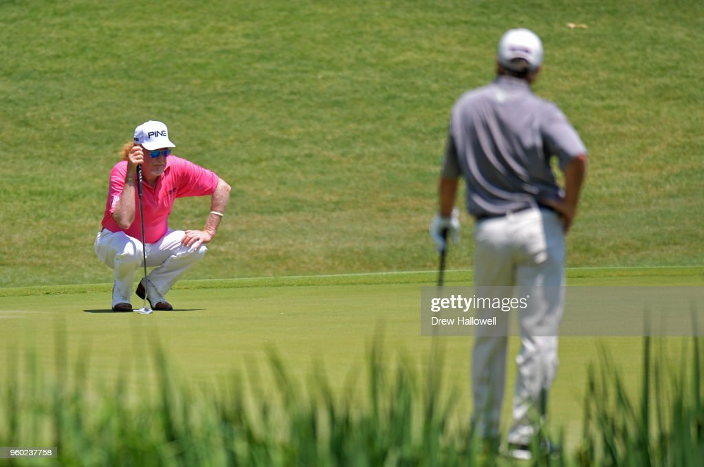 Miguel Angel Jimenez of Spain lines up a putt on the second hole as Gene Sauers of the United States looks on during the third round of the Regions Tradition at Greystone Golf & Country Club on May 19, 2018 in Birmingham, Alabama.