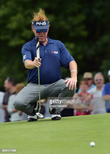 Miguel Angel Jimenez of Spain lines up his putt on the seventh hole during the first round of the 2017 US Senior Open Championship at Salem Country...