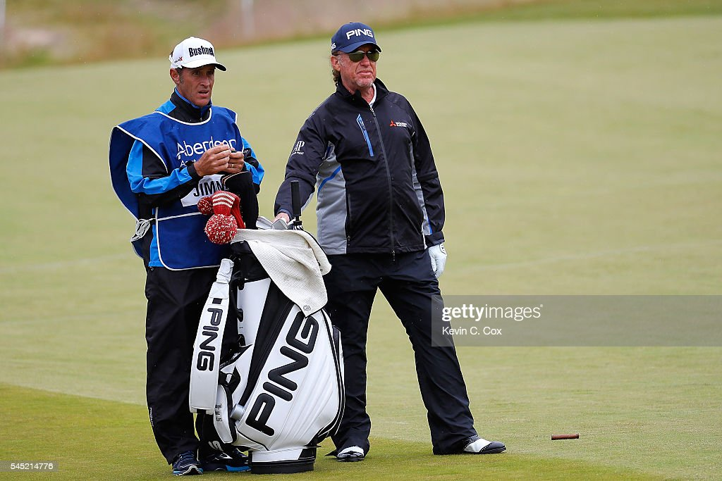 Miguel Angel Jimenez of Spain looks on with his caddie during a pro-am round ahead of the AAM Scottish Open at Castle Stuart Golf Links on July 6, 2016 in Inverness, Scotland.