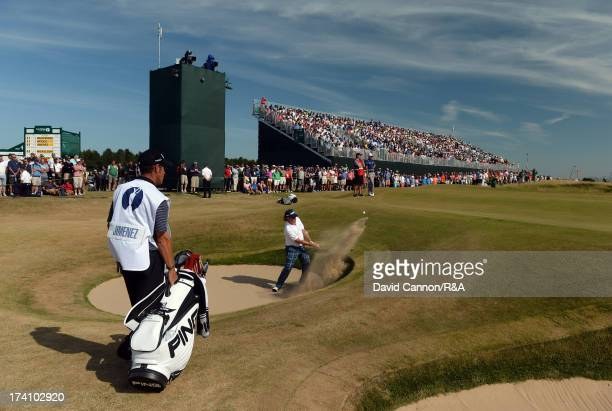 Miguel Angel Jimenez of Spain plays his fourth shot out of a bunker on the fifth hole during the third round of the 142nd Open Championship at...